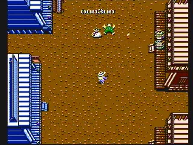 Gun.Smoke (1985)<br><br>Und auch Capcom frönte dem Wilden Westen, wie er im Filme steht: in einem Vertikalshooter, der seinem Helden mit dem vielsagenden Namen Billy Bob Dutzende Banditen auf den Hals hetzt. Von oben macht der Kopfgeldjäger Jagd auf zehn Bösewichter – zuerst in der Spielhalle, später auch auf Segas Saturn, PlayStation, dem NES oder PC. Der virtuelle Western kam endlich im Wohnzimmer an! 2092853
